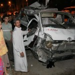 A microbus hit by a train in Mansoura